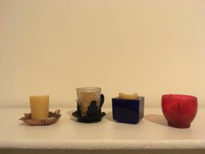 Four votive candle holders: described in surrounding text.