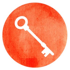 Concepts : white key at an angle on orange red circle.